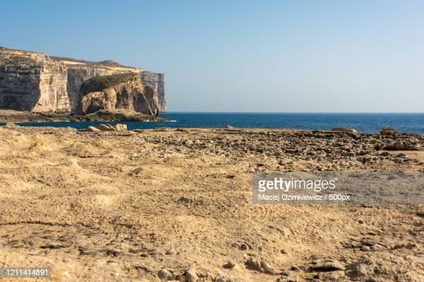 coastline of dwejra, gozo island, malta - dwejra stock-fotos und bilder
