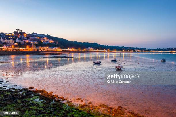 Coastline of Saint Aubin Jersey at low tide and sunset