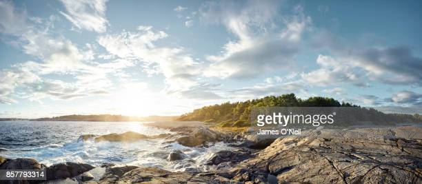 coastline panoramic at sunset, norway - extreme terrain stock pictures, royalty-free photos & images