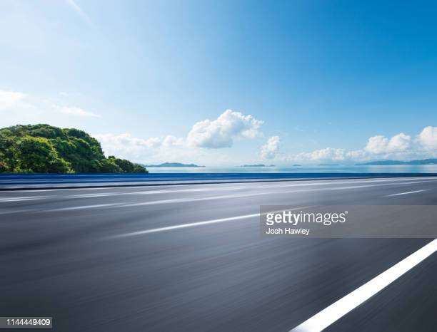 coastline road - thoroughfare stock pictures, royalty-free photos & images