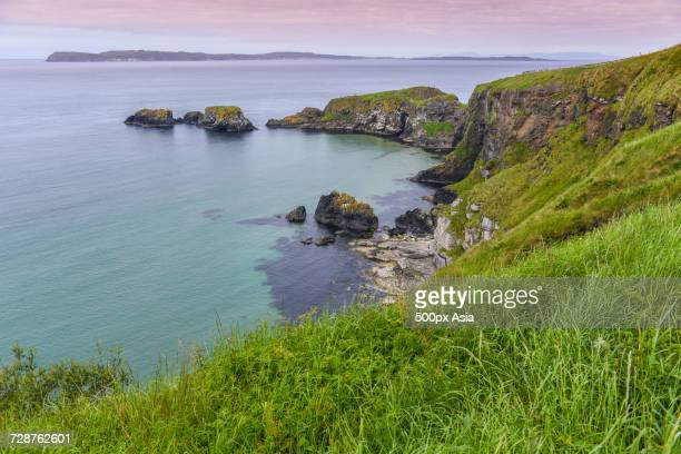 coastline with cliffs near carrick-a-rede rope bridge, ballintoy, county antrim, northern ireland, uk - image stock pictures, royalty-free photos & images