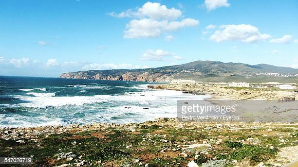 coastline with rocks - cascais stock photos and pictures