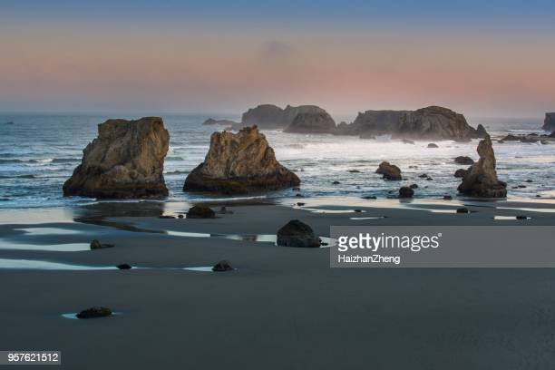 coastline with sea stacks and surf at bandon beach, oregon - rock formation stock pictures, royalty-free photos & images