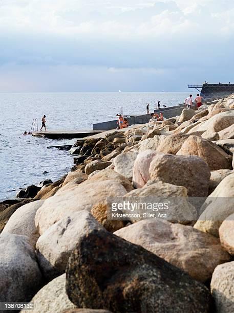Coastline with stones and pier