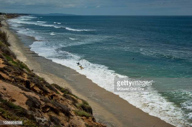 coastline with surfers - carlsbad california stock pictures, royalty-free photos & images