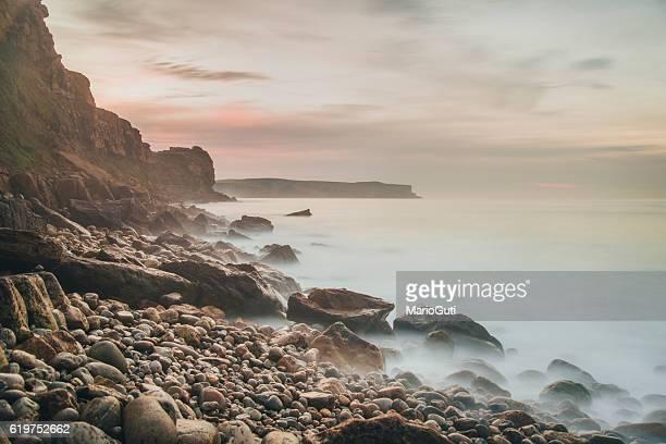 coastside at sunset - rocky coastline stock pictures, royalty-free photos & images