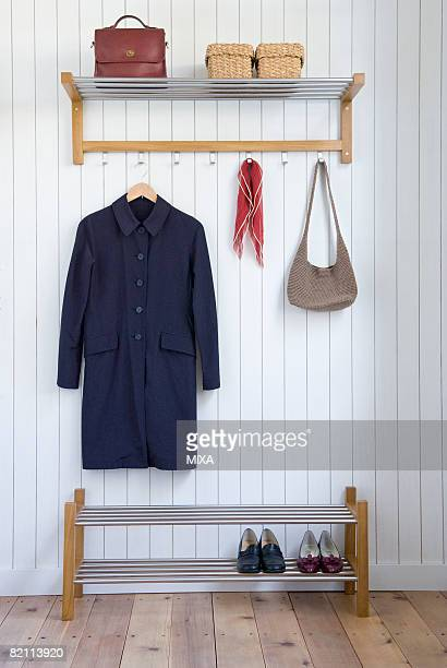coat and bag on hangers - coat garment stock pictures, royalty-free photos & images