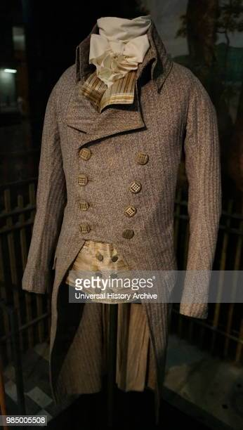 Coat and waistcoat, About 1790, England. Coat: Wool with buttons covered with silk thread. Waistcoat: printed silk.