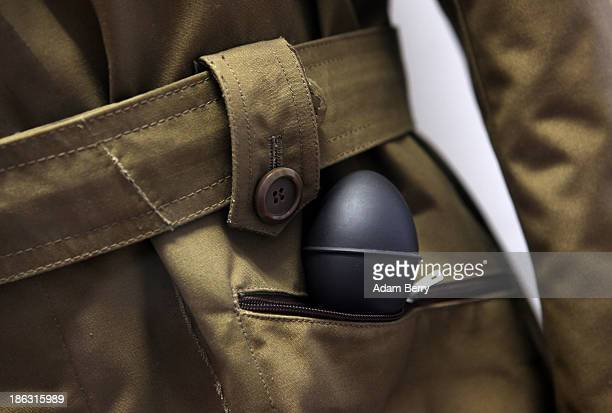 A coat featuring a hidden camera triggered by a pump in its pocket is displayed at the Stasi or East German Secret Police Museum on October 30 2013...