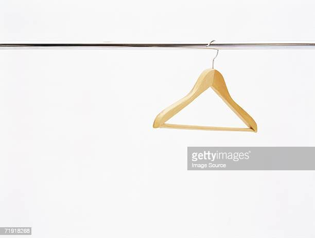coat hanger on a rail - clothes rack stock pictures, royalty-free photos & images