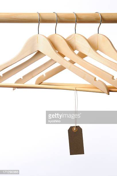 Coat hanger with blank brown tag against white background