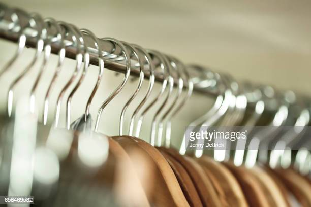 coat hangers on rack - clothes rack stock pictures, royalty-free photos & images