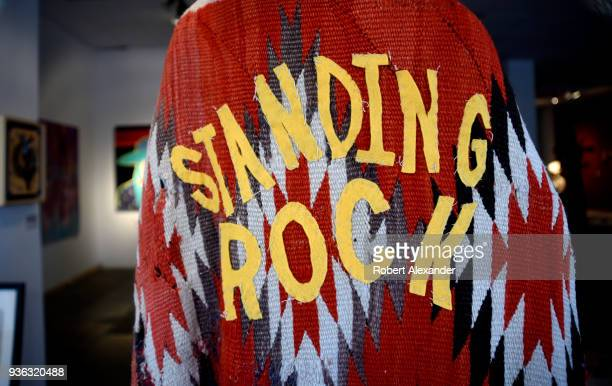 Coat made from an antique blanket for sale in a Santa Fe, New Mexico, art gallery is embellished with cutout letters spelling 'Standing Rock',...