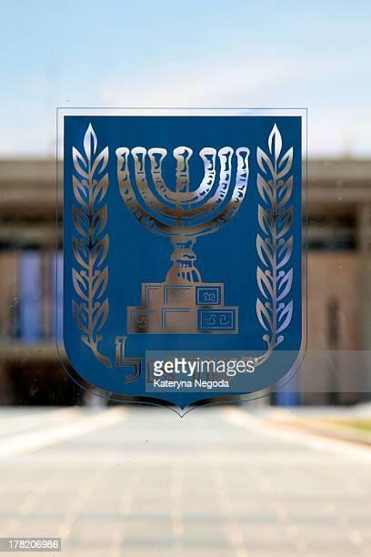 Coat of arms of Israel on a glass gates of Knesset. Jerusalem, Israel. The Knesset is the unicameral legislature of Israel.
