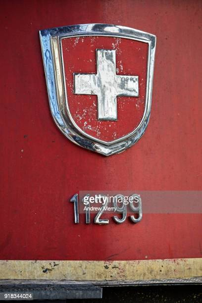 Coat of arms of Switzerland. A detail of a red Swiss train with chrome Swiss flag symbol at Zurich Central Station, Switzerland