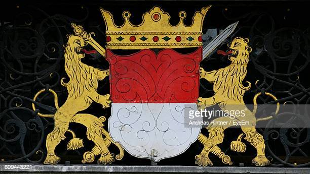 Coat Of Arms On Patterned Railing