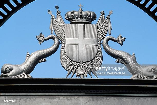 Coat of arms on the Magonale cast iron gate of the former ILVA site factory town of Follonica Tuscany Italy