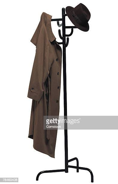 Coat rack with coat and hat