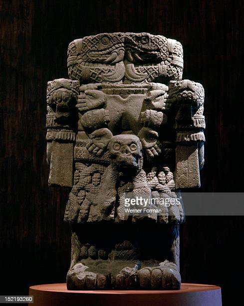 Coatlicue the Earth Mother creator of man and goddess of life and death Her head is formed from the facing heads of two rattlesnakes and she wears a...