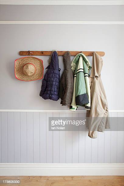 coats and hat on coat rack - jacket stock pictures, royalty-free photos & images