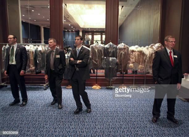 Coats are displayed during a media preview for an auction which includes jewelry and other personal items belonging to Bernard Madoff in New York US...