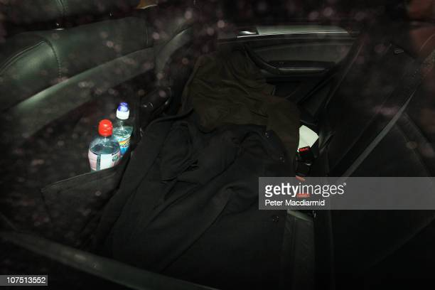 Coats cover a figure in the back of a car believed to be Shrien Dewani seen leaving Wandsworth Prison on December 10 2010 in London England Shrien...