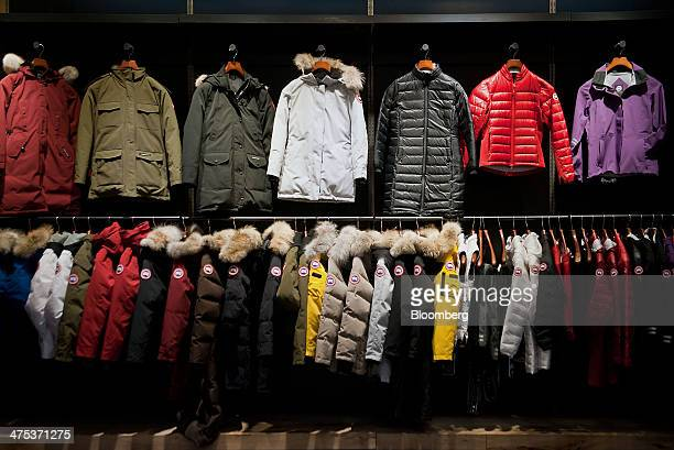 Coats hang in the show room of the Canada Goose Inc manufacturing facility in Toronto Ontario Canada on Thursday Feb 27 2014 In December Bain Capital...