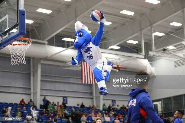 Coaty the mascot of the Delaware Blue Coats dunks during timeout against the Greensboro Swarm during a game at the 76ers Fieldhouse on January 24,...