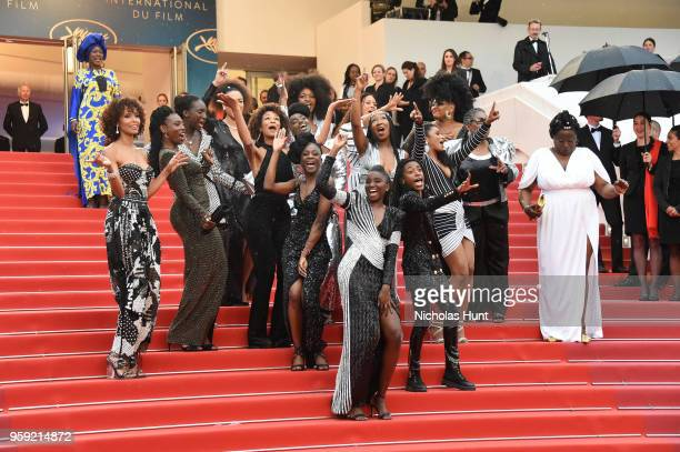 CoAuthors of the book Noire N'est Pas Mon Métier dance on the stairs at the screening of Burning during the 71st annual Cannes Film Festival at...