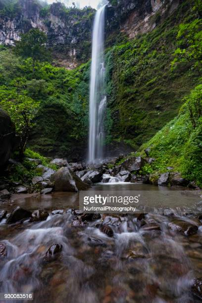 coban rondo waterfall, east java, indonesia - east java province stock photos and pictures