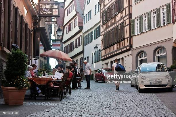 CONTENT] Cobble stone street scene of Tübingen Germany with outdoor dining