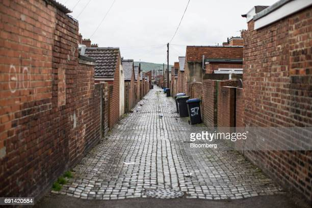 Cobble stones line a passageway along the back of residential properties in Bishop Auckland in Bishop Auckland, U.K., on Friday, May 19, 2017. This...