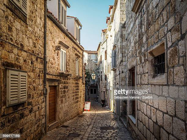 cobbled alley along buildings - hvar stock photos and pictures