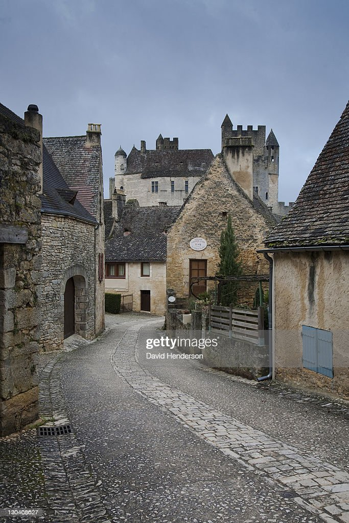 Cobbled city street with old buildings : Stock Photo