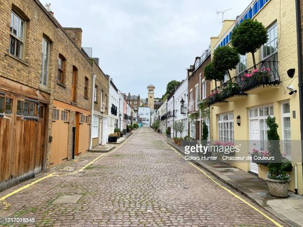 cobbled street and mews houses in south kensington - alley stock pictures, royalty-free photos & images