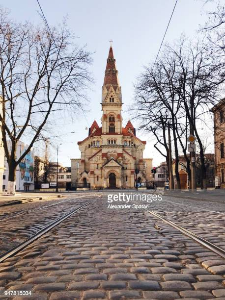 cobbled street and old church in odessa, ukraine - odessa ukraine stock photos and pictures