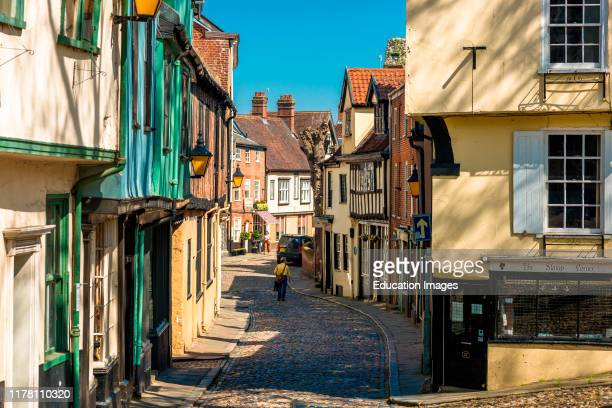 Cobbled street and shops of the medieval street of Elm Hill in Norwich city center Norfolk East Anglia England UK