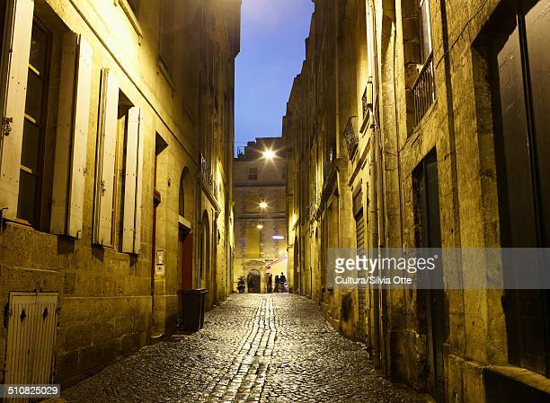 Cobbled street at night, Bordeaux, France