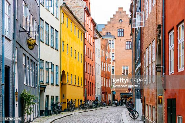cobbled street in copenhagen old town, denmark - copenhagen stock pictures, royalty-free photos & images