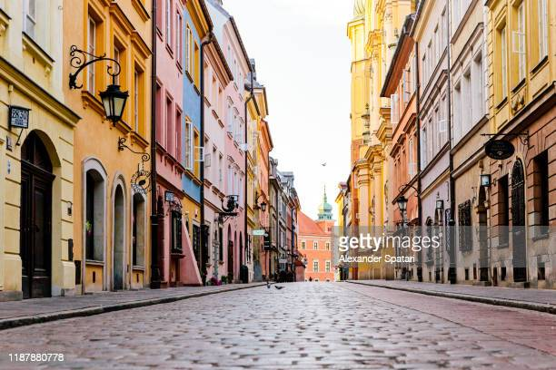 cobbled street in historic center of warsaw, poland - old town stock pictures, royalty-free photos & images