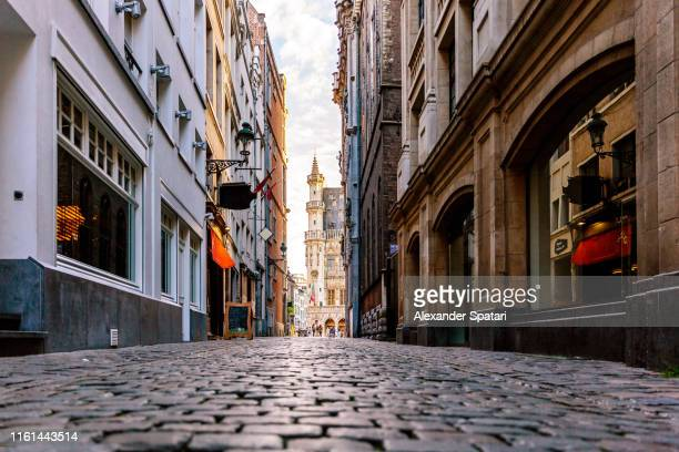 cobbled street in historical center of brussels, belgium - no people stock pictures, royalty-free photos & images