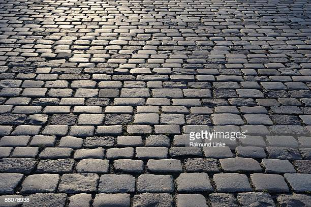 cobbled street - cobblestone stock pictures, royalty-free photos & images