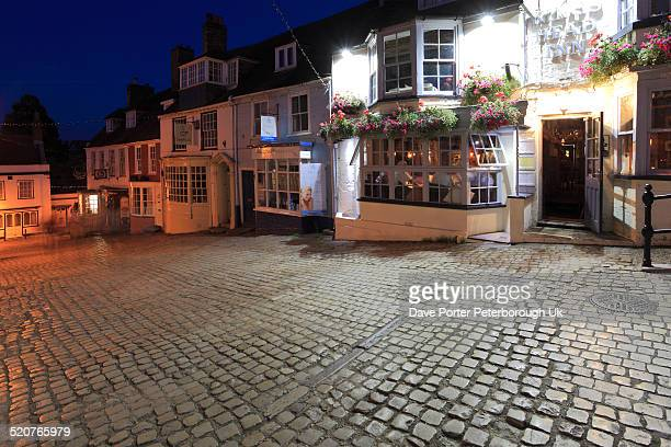 cobbled streets at night, quay hill, lymington - lymington stock photos and pictures