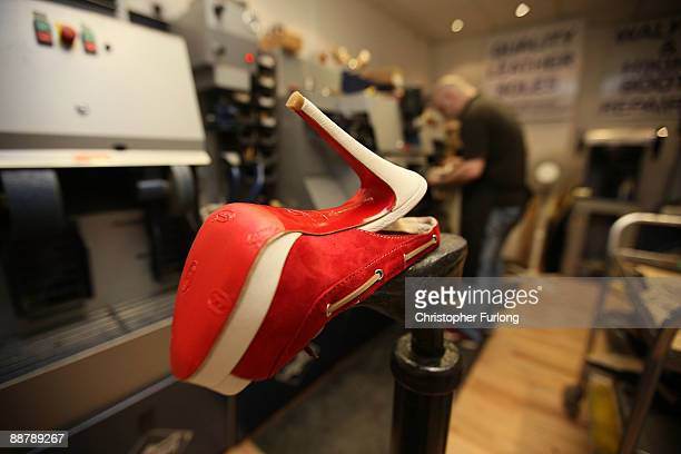 Cobbler, David Taylor works on a pair of designer shoes in his workshop in Deansgate on July 2, 2009 in Manchester, England. Since the start of the...
