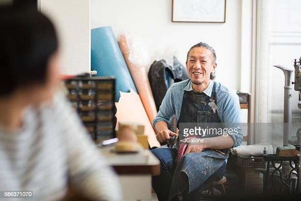 cobbler in his workshop - schuhmacher stock-fotos und bilder
