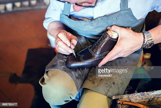 Cobbler making shoes in his workshop