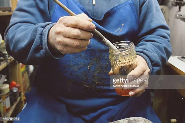 cobbler's hands, brush and glue - alexandra kleber stock-fotos und bilder