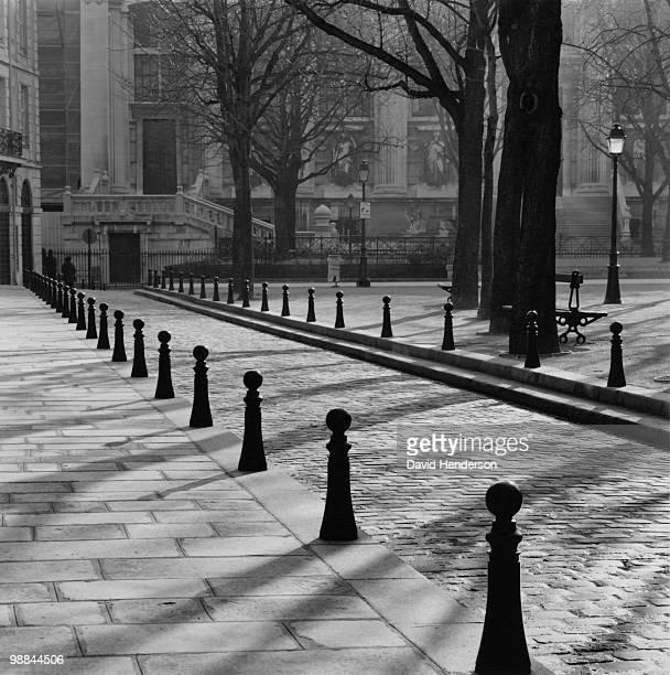 Cobblestone lane, Place Dauphine, Paris, France