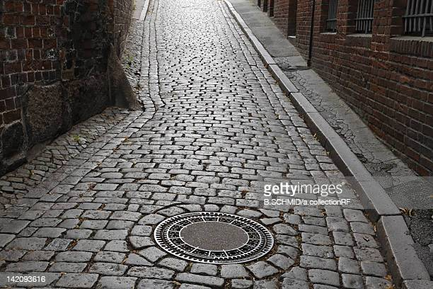 cobblestone, lubeck, schleswig-holstein, germany - schleswig holstein stock pictures, royalty-free photos & images
