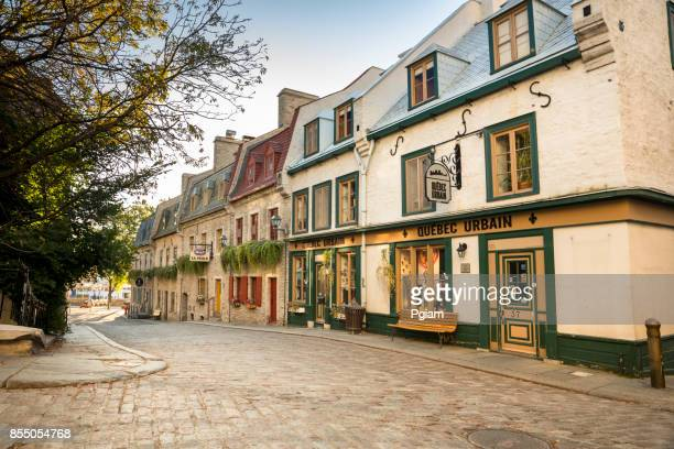 cobblestone roads of old town quebec city in canada - old quebec stock pictures, royalty-free photos & images